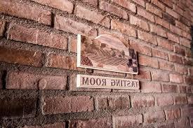 brick wall stone sign wood hang