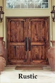 Rustic double front door Wrought Iron Nicks Building Supply The Front Door Company Where First Impressions Begin