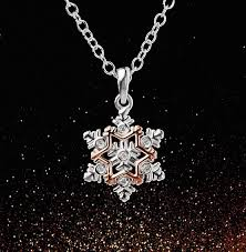 make your extra special this year by claiming a free clogau gold sterling silver 9ct gold snowflake pendant set with genuine swarovski crystals