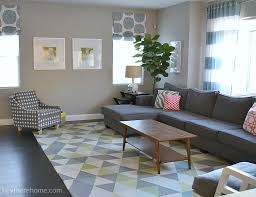 living room with greys and pops of color: a simple home decor style