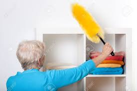 dusting furniture. Elderly Lady During Dusting Furniture At Home Stock Photo - 26312811 123RF.com