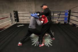 boxing trainer virgil hunter right works with fighter fernando guerrero at hunter s gym in