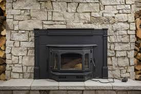 quadra fire 4100i wood burning insert with cast surround shown with tablerock stone sky high natural stone veneer