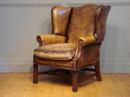 sold 20c leather wing armchair