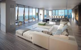 living room decor with sectional. This Expansive Living Room Is Naturally Lit Through Wraparound Floor To Ceiling Glass, And Features Decor With Sectional M