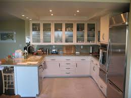 marvelous glass kitchen cabinet door design with cream ceramic floor