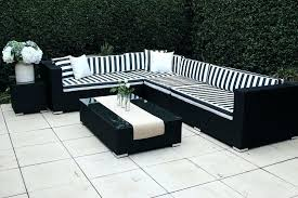 black and white patio furniture modular outdoor wicker l shaped with chair cushions rolston replacement pa
