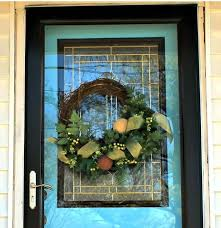 hang a wreath on a glass storm door