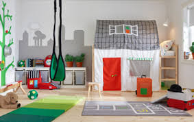 Colourful home and garden themed children's bedroom with house-shaped bed  tent and outdoor games