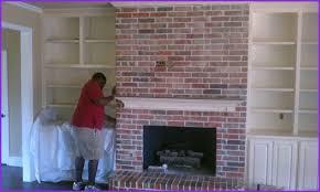 appealing mount tv over brick fireplace home design ideas of popular