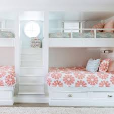bunk beds for girls with stairs. Beautiful Beds Girlsu0027 Bunk Room Features A Builtin Staircase Flanked By Built In Beds  Dressed Pink And Turquoise Bedding Intended Bunk Beds For Girls With Stairs O