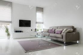 Taupe Living Room Furniture White Living Room With Taupe Leather Sofa And Glass Table On