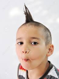 Kid Hair Style cute little boy with funny hair and cheerful grimace stock photo 3259 by wearticles.com