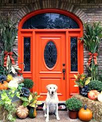 Orange front door Feng Shui Orange Front Door Vintage Orange Front Door With Glass Pane And Pumpkins Highlighting It Orange Orange Front Door Little House Design Orange Front Door Modern Exterior Photo Green Door Images Orange