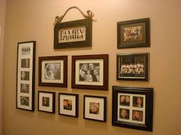 Arranging Photos On A Wall About Family