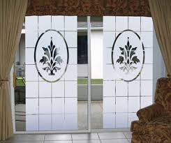 d etched glass design on wide sliding glass doors decorate that wall of glass d etched glass design adds a decorative focus while reducing