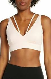 New Balance <b>Evolve</b> Strappy sports bra pale pink size M | eBay