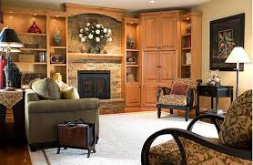 brick fireplace and pale yellow wall color for beautiful family room ideas with built in wooden cabinet