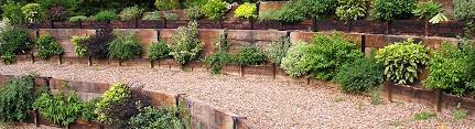 how to build a retaining sleeper wall