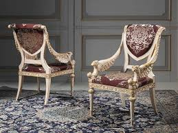 royal classic chair design in classy living room with fl carpet and gray wooden panel decoration ideas