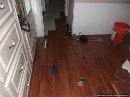 allen roth laminate flooring being installed in a bedroom into the hallway 10mm