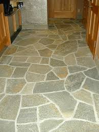 this type of natural stone has a rough and porous surface when first installed the floor has a very grey appearance and holds onto dirt and stains at the