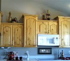 view of knotty alderwood kitchen cupboards when the finish yellowed