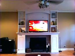 mounting tv above fireplace hiding wires install