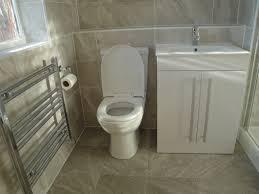 grey stone effect floor tiles with toilet towel warmer and vanity basin
