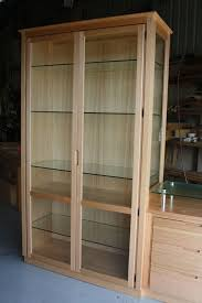 display cabinet with glass doors amusing natural tall display cabinets design ideas presenting interior decorating
