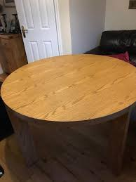 oak veneered round table with solid oak base