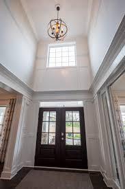 2 story foyer chandelier. Window And A Orbital Light Fixture Brighten The 2-story Foyer In An Infinity Custom Home. 2 Story Chandelier S