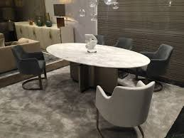 oval dining table with marble on top