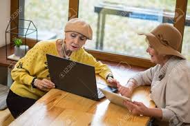Two Old Women And Laptop Elderly Ladies With Tablet Compare