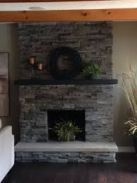 stacked stone over brick fireplace remodel like how the stone goes to the ceiling would have to remove mirror