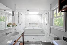 bathroom with a freestanding tub inside a glass enclosed marble shower white vein y