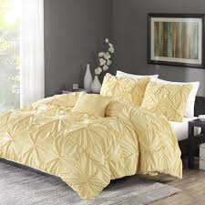 yellow ruched duvet cover with nightstand and rug
