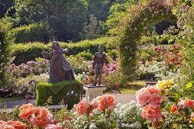 alice in wonderland sculptures in the jubilee rose garden earlier this summer at rhs garden wisley