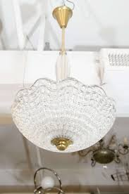 a beautiful scandinavian modern clear crystal and brass chandelier by carl erlund for orrefors the