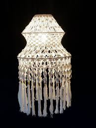 white lamp by the knotted touch min