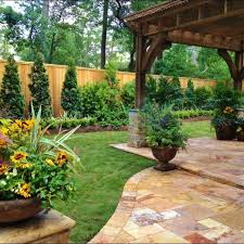 backyard landscaping ideas along fence  Backyard and yard design for  village