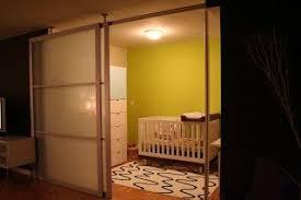 room divider using Stolmen poles and IKEA sliding doors