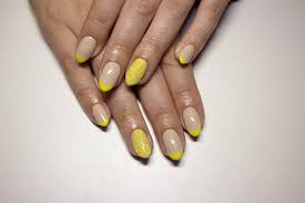paint all your nails with cream nail polish use yellow nail polish to color