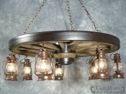 wagon wheel chandelier with downlights large wagon wheel chandelier with lanterns small wagon wheel chandelier downlights