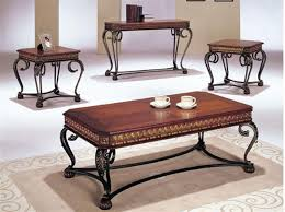 coffee and end tables sets wood and iron top there are shades and gold engraving bagiak