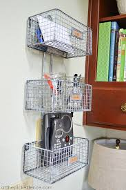the right bin or basket might have slots for mail s and the phone itself