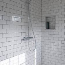 White Subway Tile Shower With Contemporary Showerhead