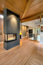 ideas of decorating a room using 3 sided gas fireplace ceilings with recessed lihting and