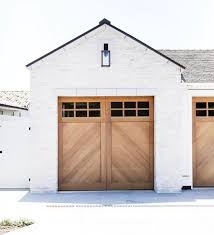 This is just so perfect. Natural wood garage on a white brick house ...