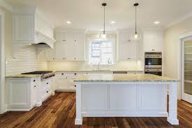 white kitchen with dark wood floors gorgeous kitchens with wooden flooring